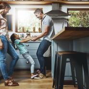 Family hanging out in kitchen together.